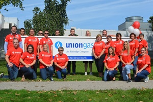 Union Gas employees in front of banner