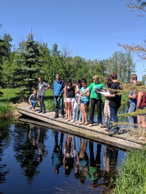 High school students at a pond