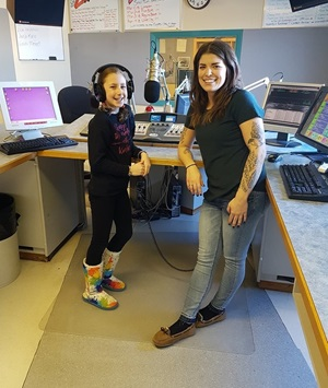 Girl on the air with DJ at radio station