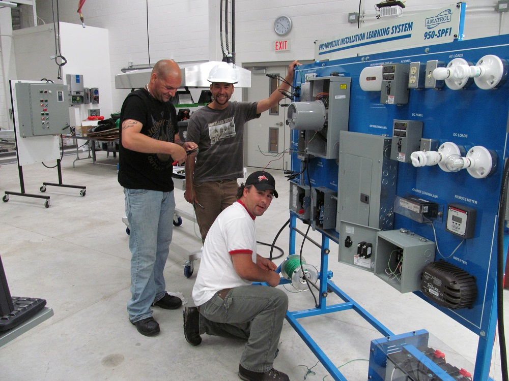 Students work on wiring in college lab