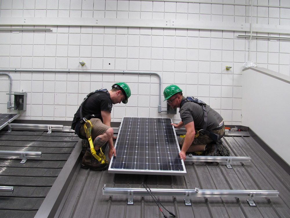Students fix a solar panel