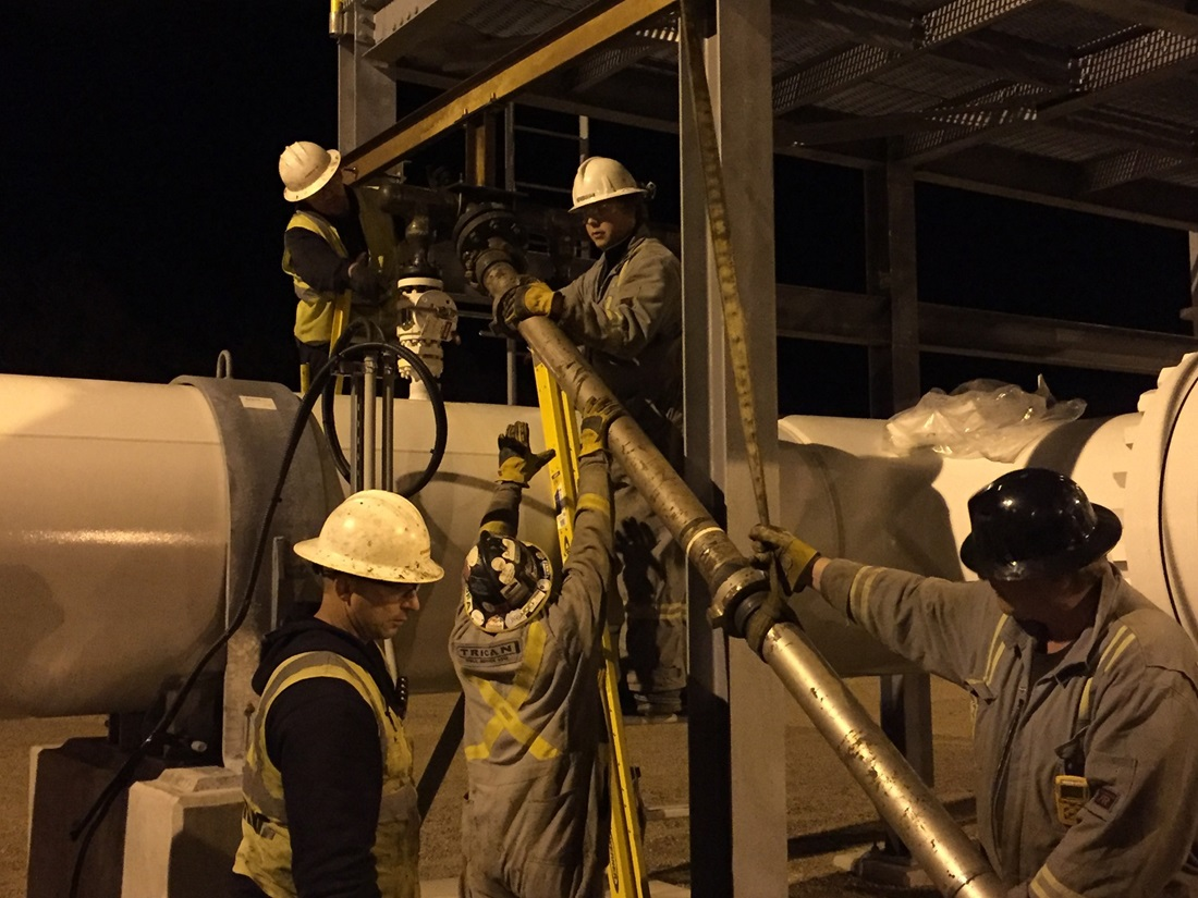 Fluid withdrawal pipe installation at night