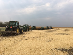 Several tractors in field