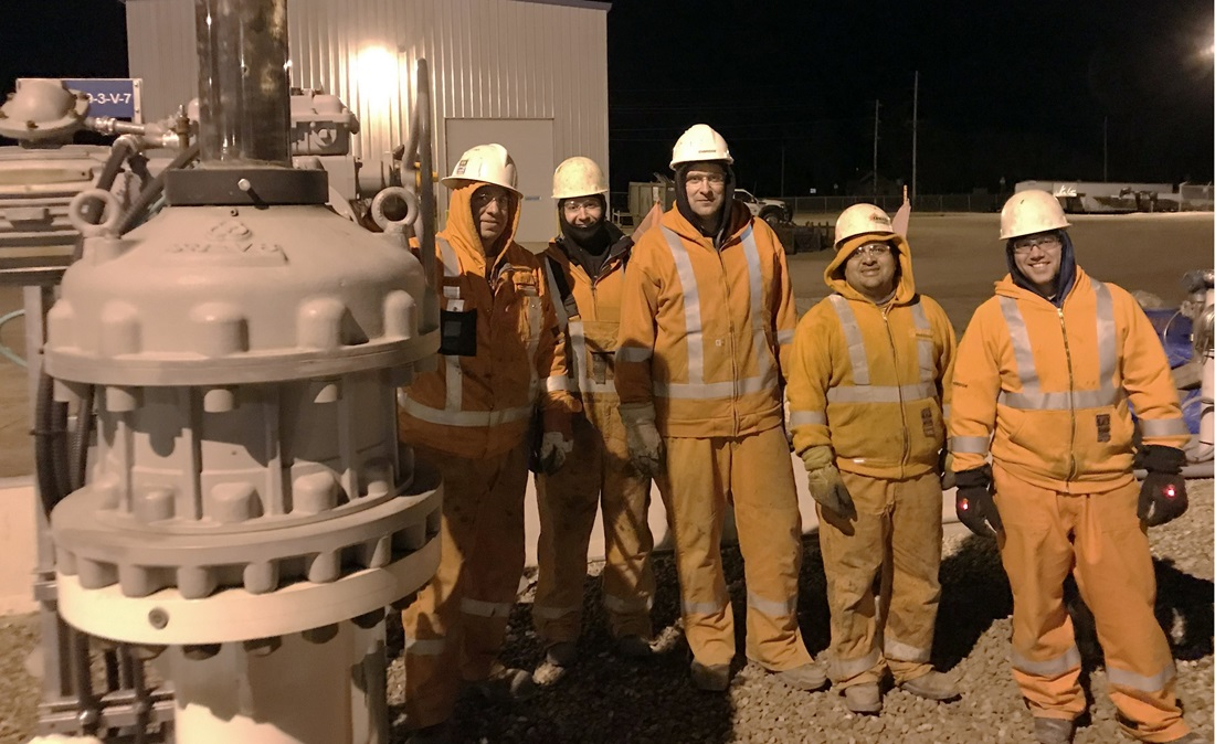 Workers with pipeline tie-in