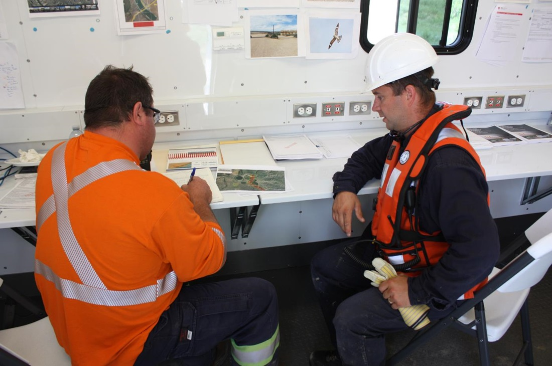 Safety workers in a trailer