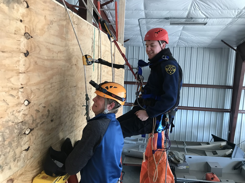 rescue volunteers on climbing wall